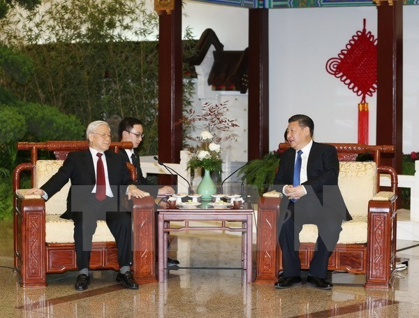 Party General Secretary Nguyen Phu Trong and Chinese Party General Secretary and President Xi Jinping (Photo: VNA)